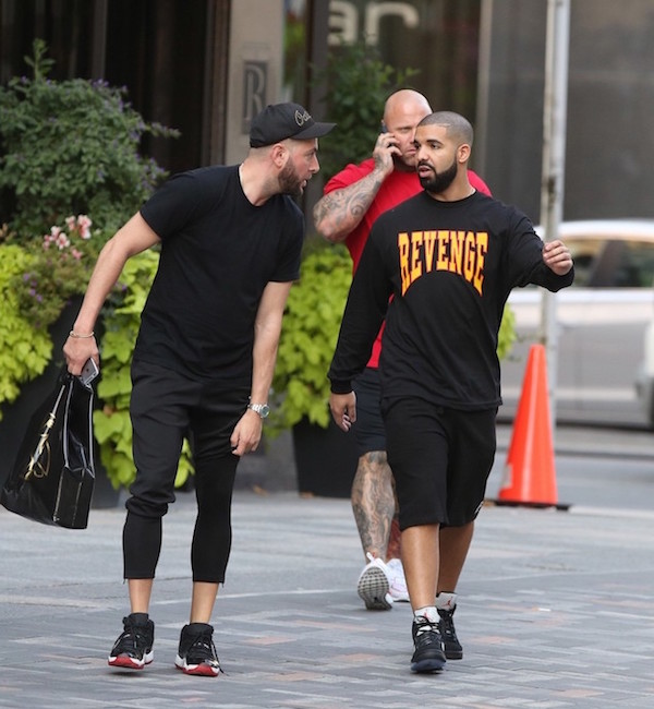 drake-wearing-Revenge-OVO-tour-sweatshirt-and-Air-Jordan-5-Retro-Sneakers-Shoes-1.jpg